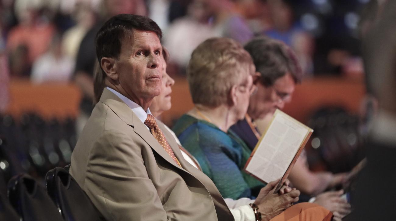 In this July 14, 2016 photo, Tennessee athletic director Dave Hart, left, waits for the start of the ceremony to celebrate the life of former Tennessee women's basketball coach Pat Summitt in Knoxville, Tenn. Hart acknowledges this has been an emotional y