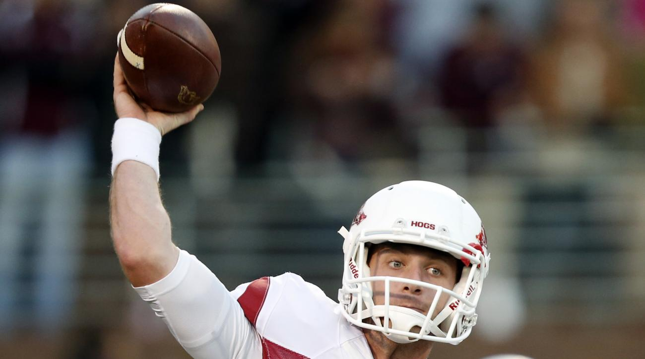 FILE - In this Nov. 1, 2014, file photo, Arkansas quarterback Austin Allen (8) throws before an NCAA college football game against Mississippi State,  in Starkville, Miss. Austin Allen can't remember the last time he's taken a hit during a game. That figu