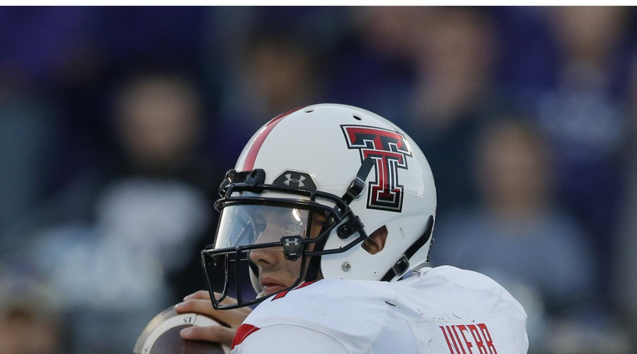 Texas Tech quarterback Davis Webb (7) passes to a teammate during the first half of an NCAA college football game against Kansas State in Manhattan, Kan., Saturday, Oct. 4, 2014. (AP Photo/Orlin Wagner)