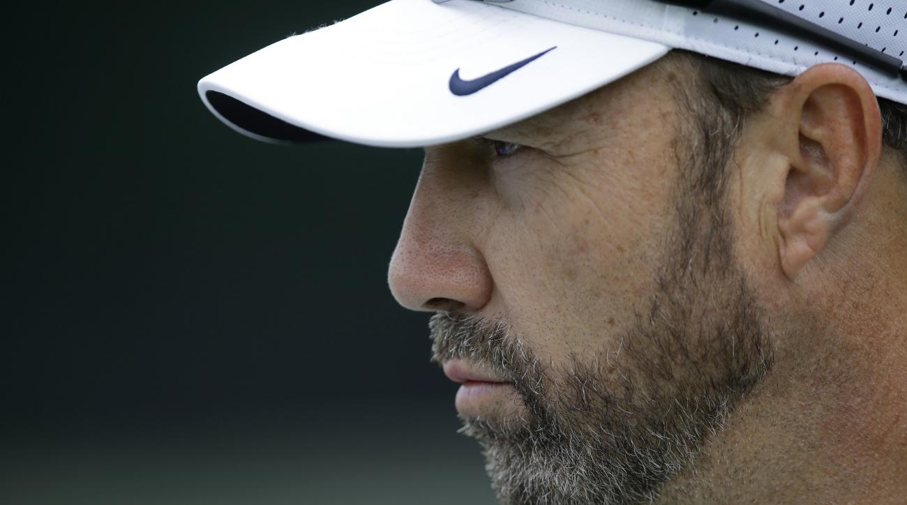 North Carolina head coach Larry Fedora keeps a watchful eye on his players during the team's first NCAA college football practice of the season in Chapel Hill, N.C., Friday, Aug. 5, 2016. (AP Photo/Gerry Broome)