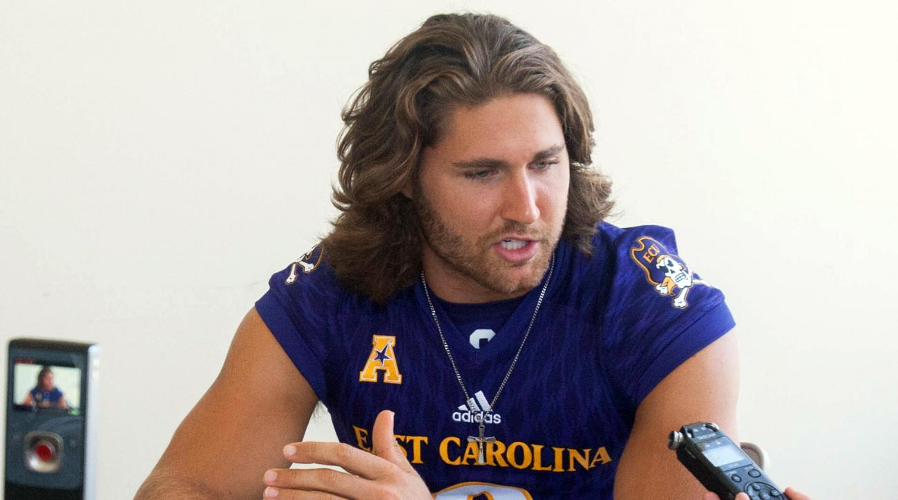 East Carolina University's Philip Nelson (9) answers questions about the upcoming football season during media day in Greenville, N.C., Saturday, Aug. 6, 2016. Nelson is out to make the most of his second chance at East Carolina. The 22-year-old former st