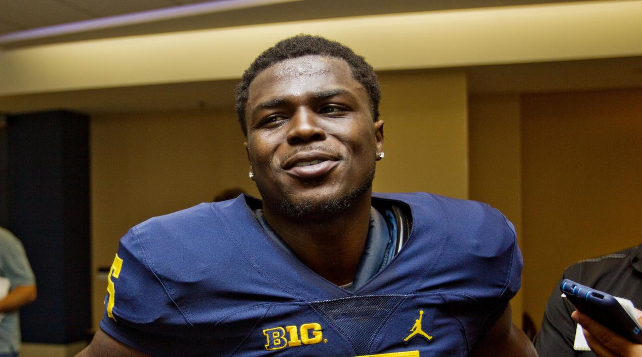 Michigan safety Jabrill Peppers speaks to reporters during the NCAA college football team's preseason media day at Michigan Stadium in Ann Arbor, Mich., Sunday, Aug. 7, 2016. (AP Photo/Tony Ding)