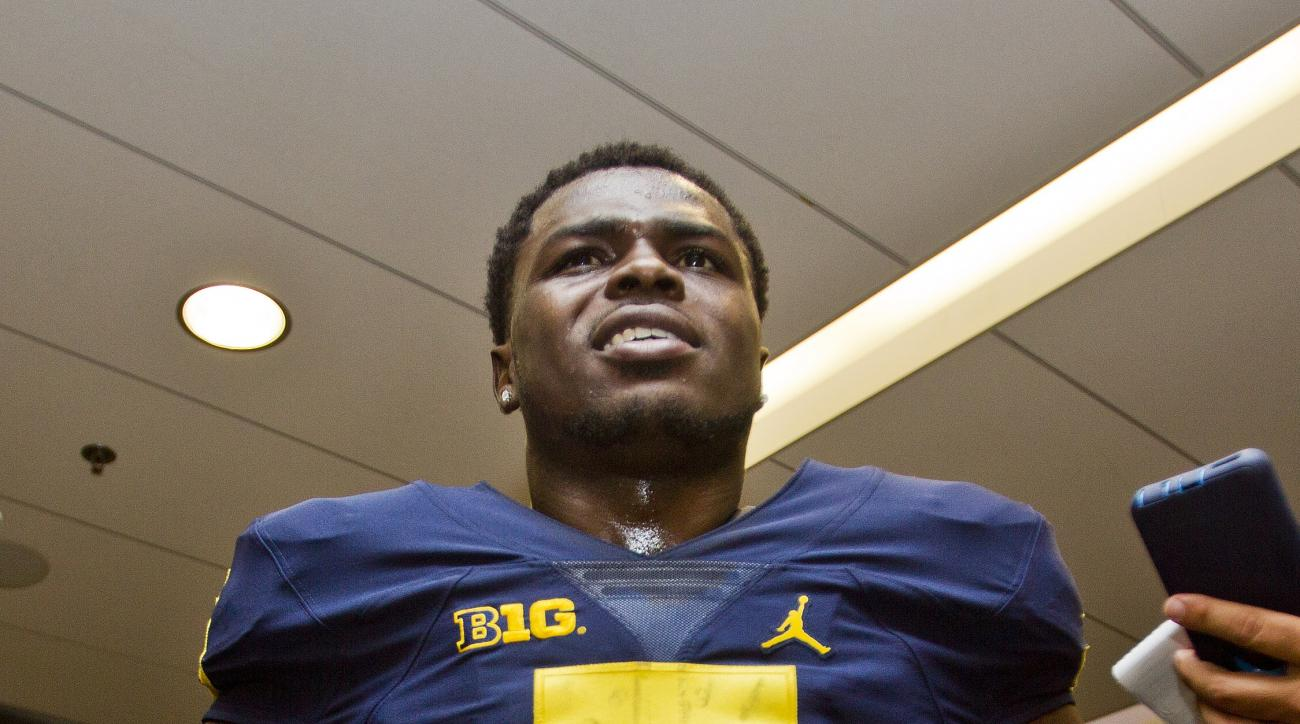 Michigan safety Jabrill Peppers speak to reporters during the NCAA college football team's preseason media day at Michigan Stadium in Ann Arbor, Mich., Sunday, Aug. 7, 2016. (AP Photo/Tony Ding)