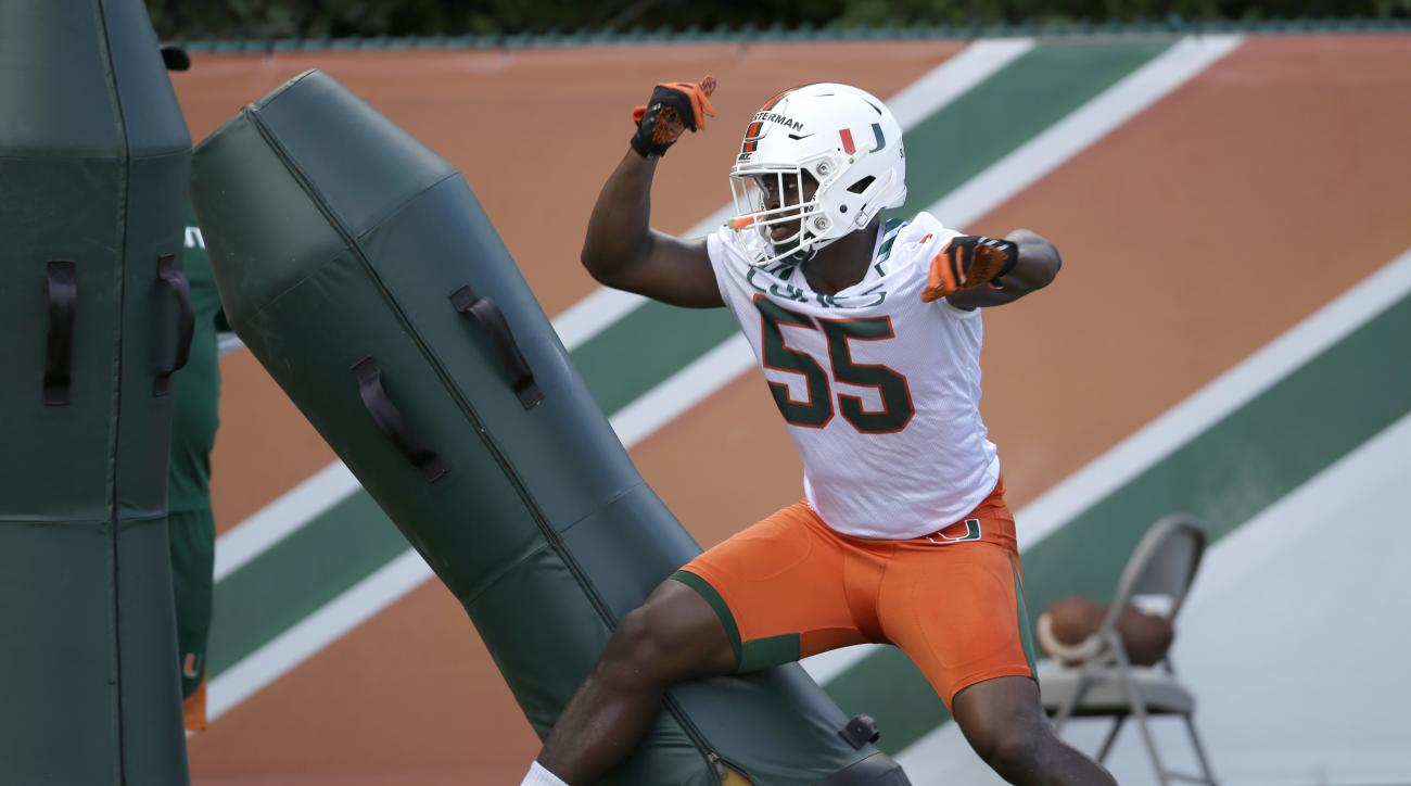 FILE - In this Aug. 5, 2016, file photo, Miami linebacker Shaquille Quarterman runs a drill during the NCAA college football team's practice, in Coral Gables, Fla. The Hurricanes have such high hopes for freshman linebacker Shaquille Quarterman that they