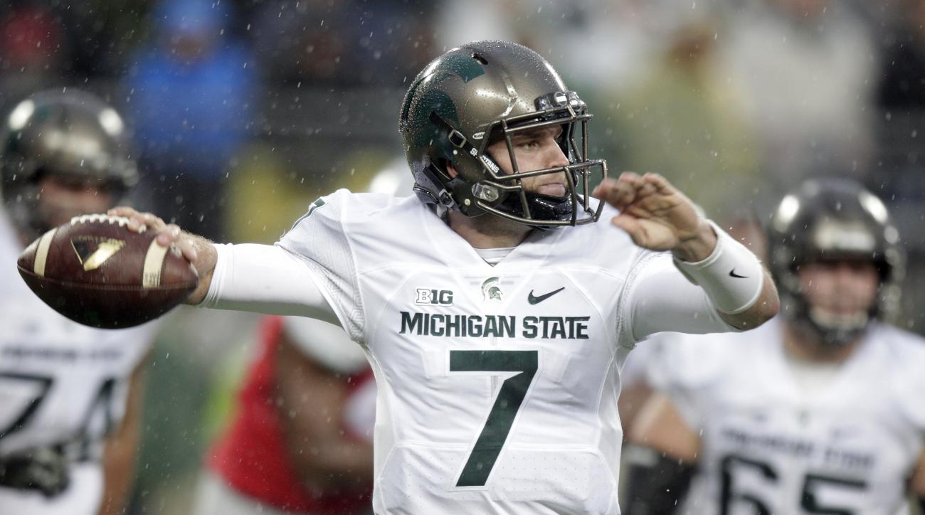 FILE - In this Nov. 21, 2015, file photo, Michigan State quarterback Tyler O'Connor throws a pass against Ohio State during the second quarter of an NCAA college football game, in Columbus, Ohio.Michigan State coach Mark Dantonio says fifth-year senior Ty
