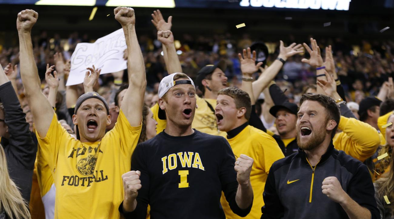 FILE - In this Dec. 5, 2015, file photo, Iowa fans cheer after quarterback C.J. Beathard threw an 85-yard touchdown to Tevaun Smith during the second half of the Big Ten Conference championship NCAA college football game against Michigan State, in Indiana