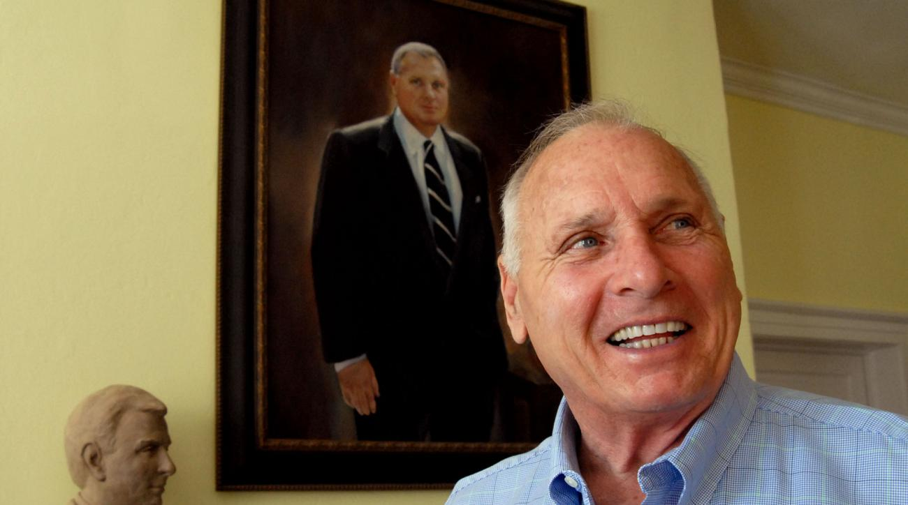 ** ADVANCE FOR WEEKEND EDITIONS, OCT. 7-8 **Former college football coach Bill Dooley talks about his career, Wednesday, Oct. 4, 2006, as he stands in front of both a portrait and a bust of himself in the living room of his home in Wrightsville Beach, N.C