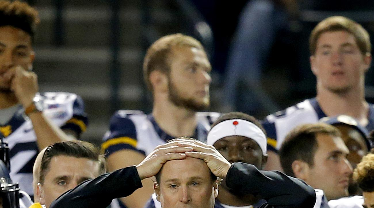 FILE - In this Jan. 2, 2016, file photo, West Virginia coach Dana Holgorsen watches during the first half of the Cactus Bowl NCAA college football game against Arizona State, in Phoenix. In a pivotal year for embattled coach Holgorsen, the Mountaineers re
