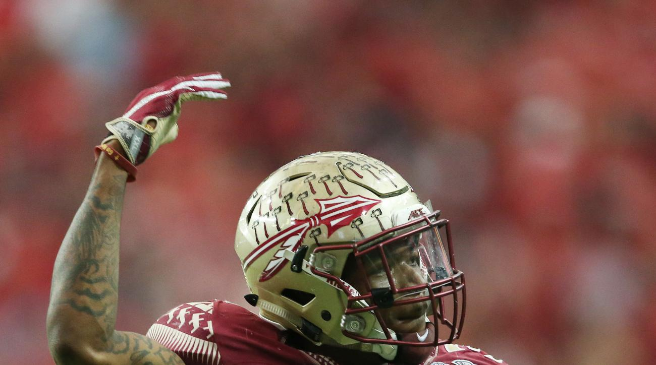 FILE- In this Dec. 31, 2015, file photo, Florida State defensive back Derwin James (3) celebrates a tackle during the second half of the Peach Bowl NCAA college football game, in Atlanta. With 17 starters returning, the spotlight was already on Florida St