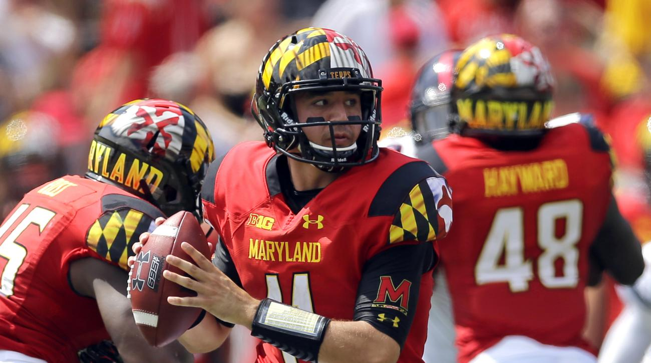 FILE - In this Sept. 5, 2015, file photo, Maryland quarterback Perry Hills looks for a receiver in the first half of an NCAA college football game against Richmond,in College Park, Md. (AP Photo/Patrick Semansky, FIle)