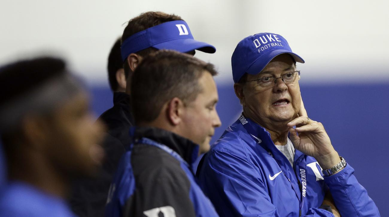 In this photo taken Monday, Aug. 8, 2016 Duke head coach David Cutcliffe, right, speaks with assistants during an NCAA college football practice in Durham, N.C. (AP Photo/Gerry Broome)