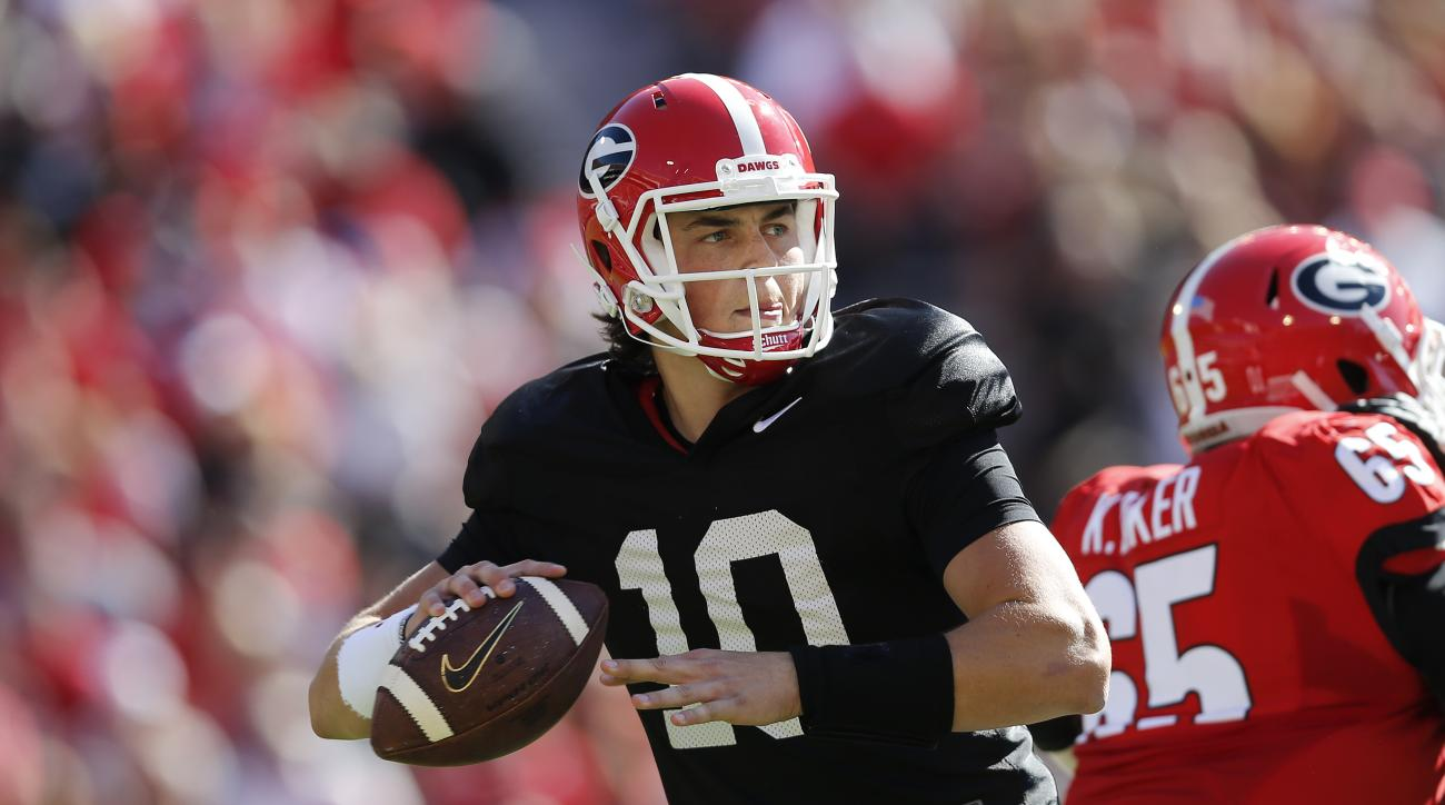 FILe - In this April 16, 2016, file photo, Georgia quarterback Jacob Eason throws during the first half of their spring intrasquad NCAA college football game in Athens, Ga. Freshman Jacob Eason, the biggest prize in Kirby Smarts first recruiting class, sh