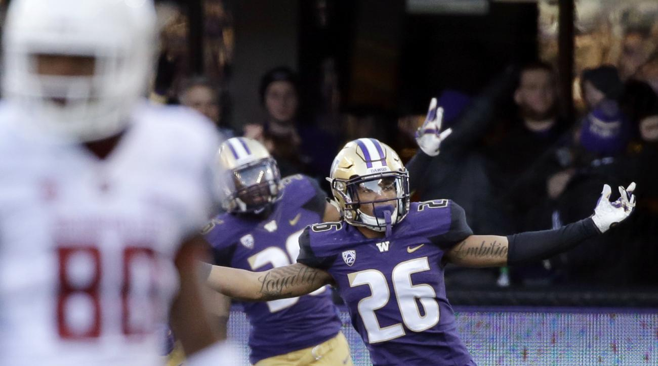 FILE -- In this Nov. 27, 2015, file photo, Washington's Sidney Jones celebrates scoring a touchdown on an interception against Washington State in an NCAA college football game in Seattle. (AP Photo/Elaine Thompson, File)