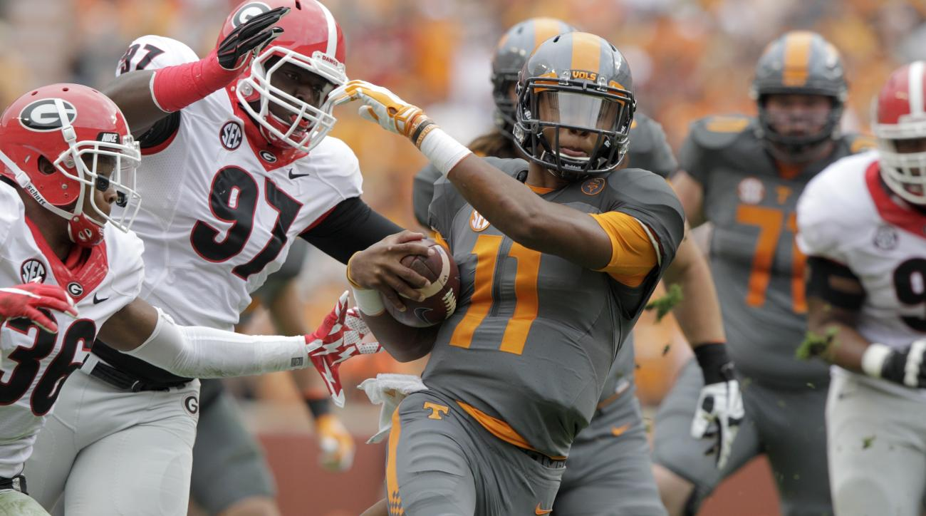 FILE - In this Oct. 10, 2015, file photo, Tennessee quarterback Joshua Dobbs (11) runs the ball during an NCAA college football game against Georgia, in Knoxville, Tenn. This is the season Tennessee has been pointing to for years. Tennessee ended a string