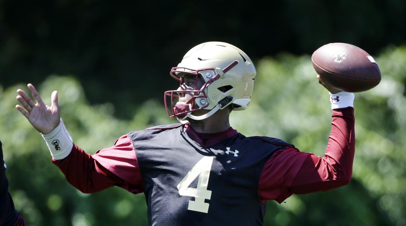 Boston College quarterback Darius Wade throws a football during football practice, Monday, Aug. 8, 2016, in Boston. (AP Photo/Elise Amendola)