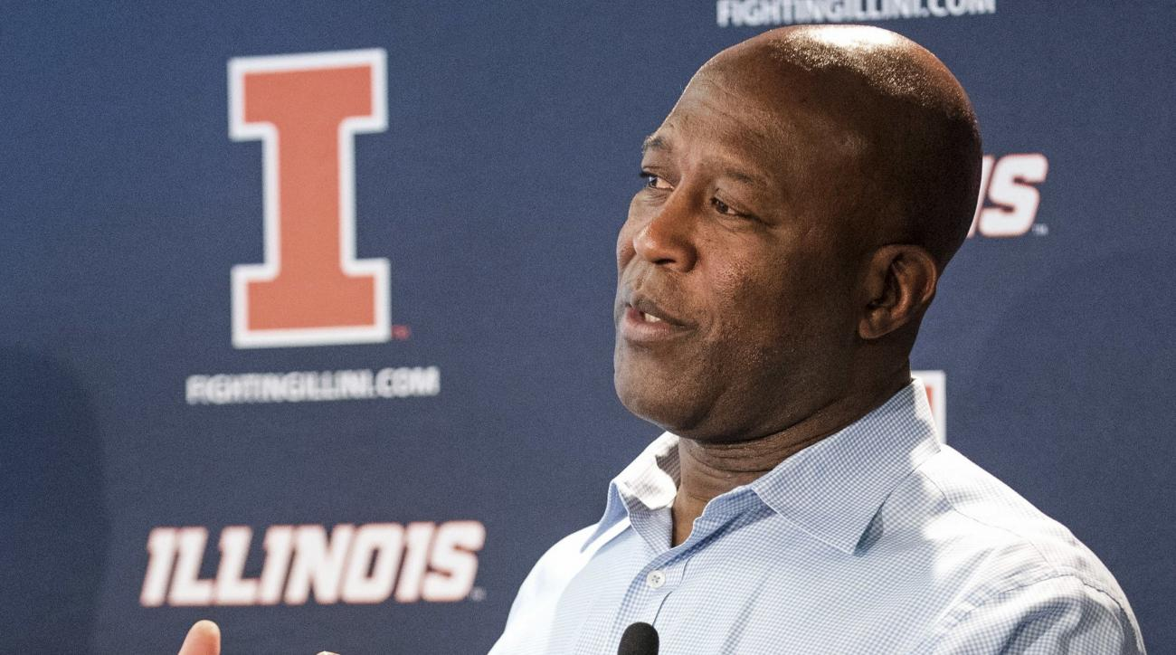 FILE - In this March 29, 2016 file photo, Illinois football coach Lovie Smith speaks with the media at an NCAA college football press conference at Memorial Stadium in Champaign, Ill. Smith takes over an Illinois team with some talent, but little depth an