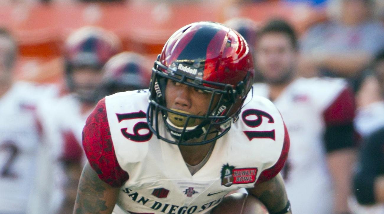FILE -- In this Dec. 24, 2015, file photo, San Diego State running back Donnel Pumphrey (19) carries against Cincinnati during the Hawaii Bowl NCAA college football game in Honolulu. (AP Photo/Eugene Tanner, File)