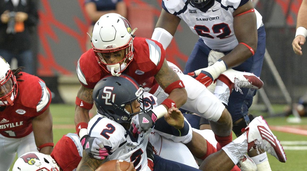 FILE - In this Sept. 26, 2015, file photo, Samford quarterback Michael Eubank (2) is sacked by Louisville nose tackle Deangelo Brown, bottom, and cornerback Jaire Alexander during the first half of their NCAA college football game, in Louisville, Ky. (AP