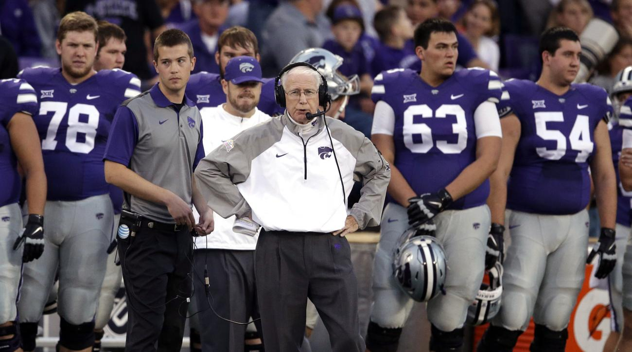 FILE - In this Oct. 10, 2015, file photo, Kansas State head coach Bill Snyder, center, stands with his team during the first half of an NCAA college football game against TCU in Manhattan, Kan. As the 76-year-old Snyder enters his 26th season, there are g