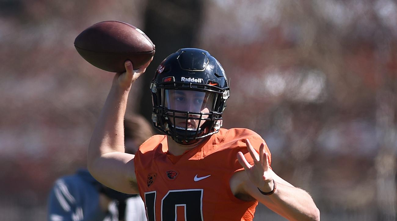 FILE - In this March 29, 2016 file photo, Oregon State Beavers quarterback Darell Garretson throws a pass during spring NCAA college football practice in Corvallis, Ore. After last season's quarterback carousel at Oregon State, Darell Garretson heads into