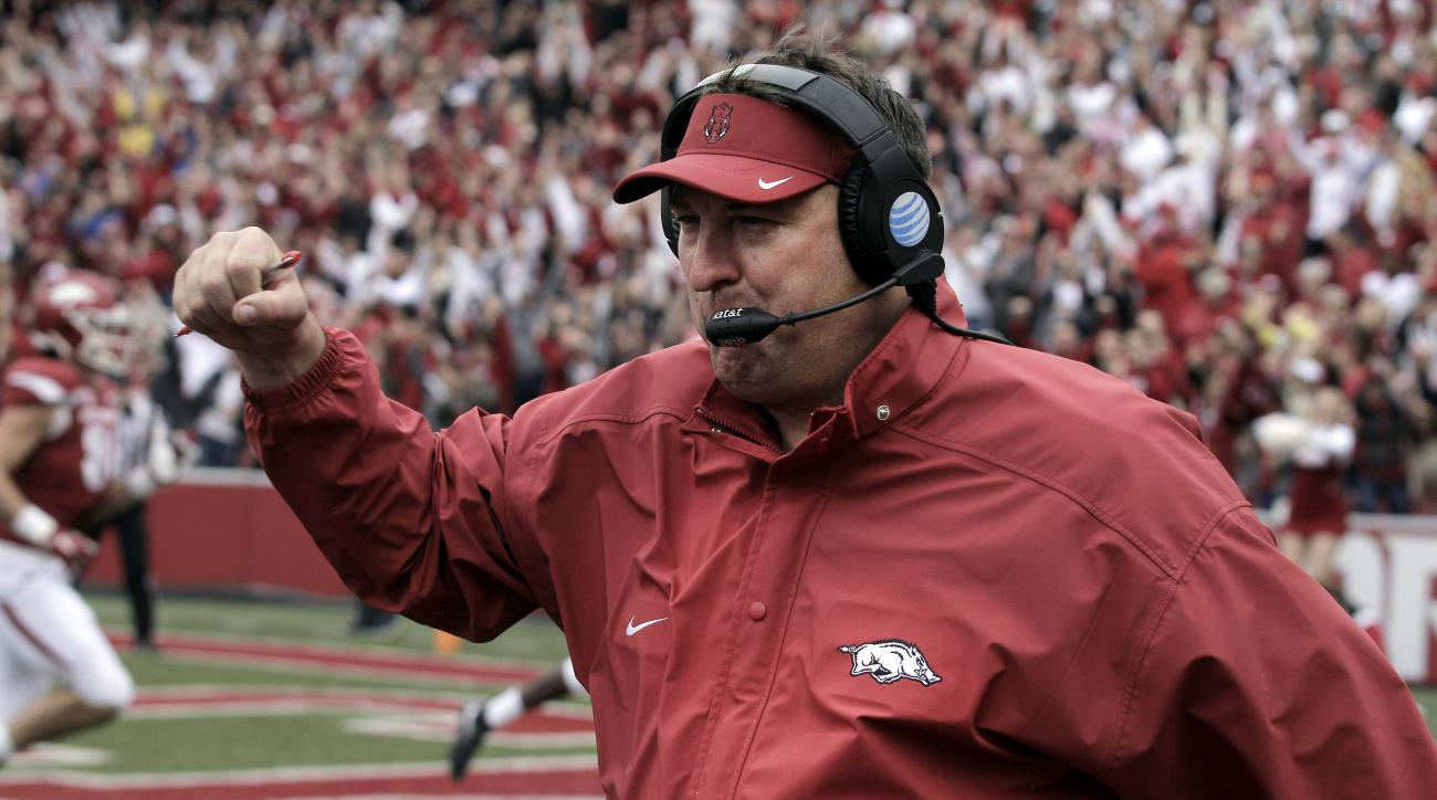 FILE - In this Oct. 24, 2015, file photo, Arkansas' Bret Bielema celebrates after a touchdown during the fourth overtime of an NCAA college football game against Auburn, in Fayetteville, Ark. Arkansas has improved its win total in each of its first three