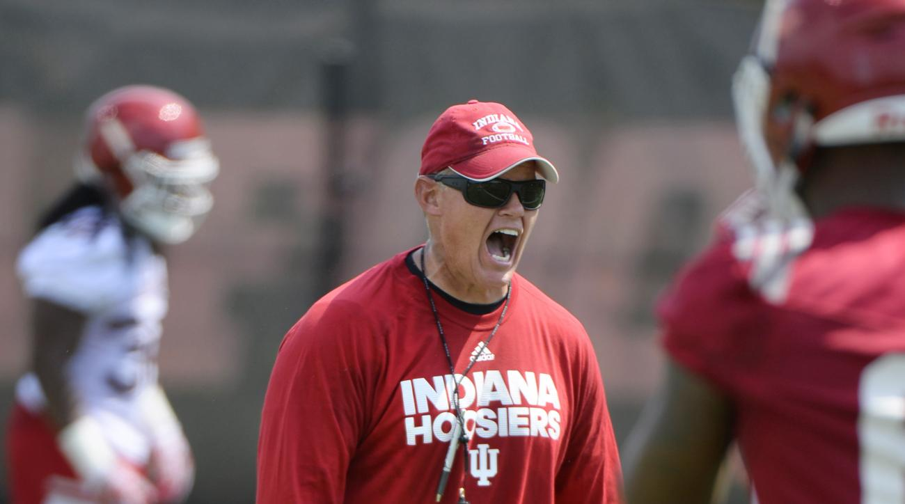 In this Wednesday, Aug. 3, 2016 photo, Indiana defensive coordinator Tom Allen directs players during NCAA college football practice in Bloomington, Ind.  Allen began his latest rebuilding project by asking his players to believe in themselves. Now comes