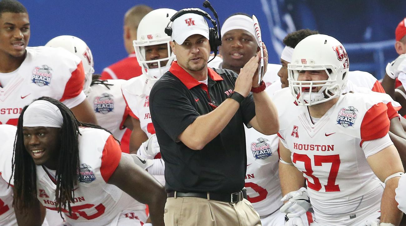 FILE - In this Dec. 31, 2015, file photo, Houston head coach Tom Herman watches play against Florida State during the first half of the Peach Bowl NCAA college football game in Atlanta. The AAC notched 10 wins in 2015 against Power Five conference teams,
