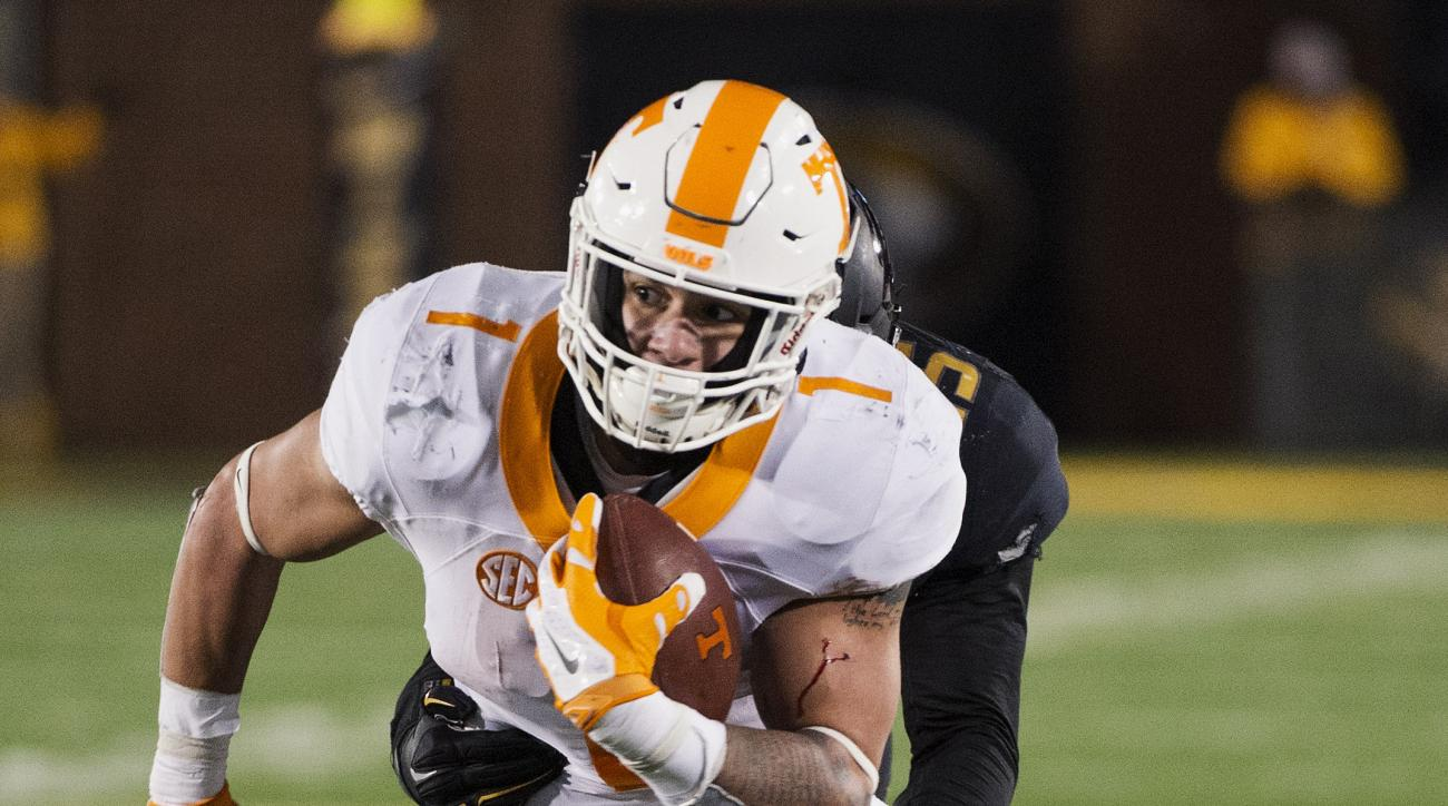 FILE - This Nov. 21, 2015, file photo shows Tennessee running back Jalen Hurd, being wrapped up by Missouri's Donavin Newsom, left, during the second quarter of an NCAA college football game in Columbia, Mo. The talent at running back is so loaded that gu