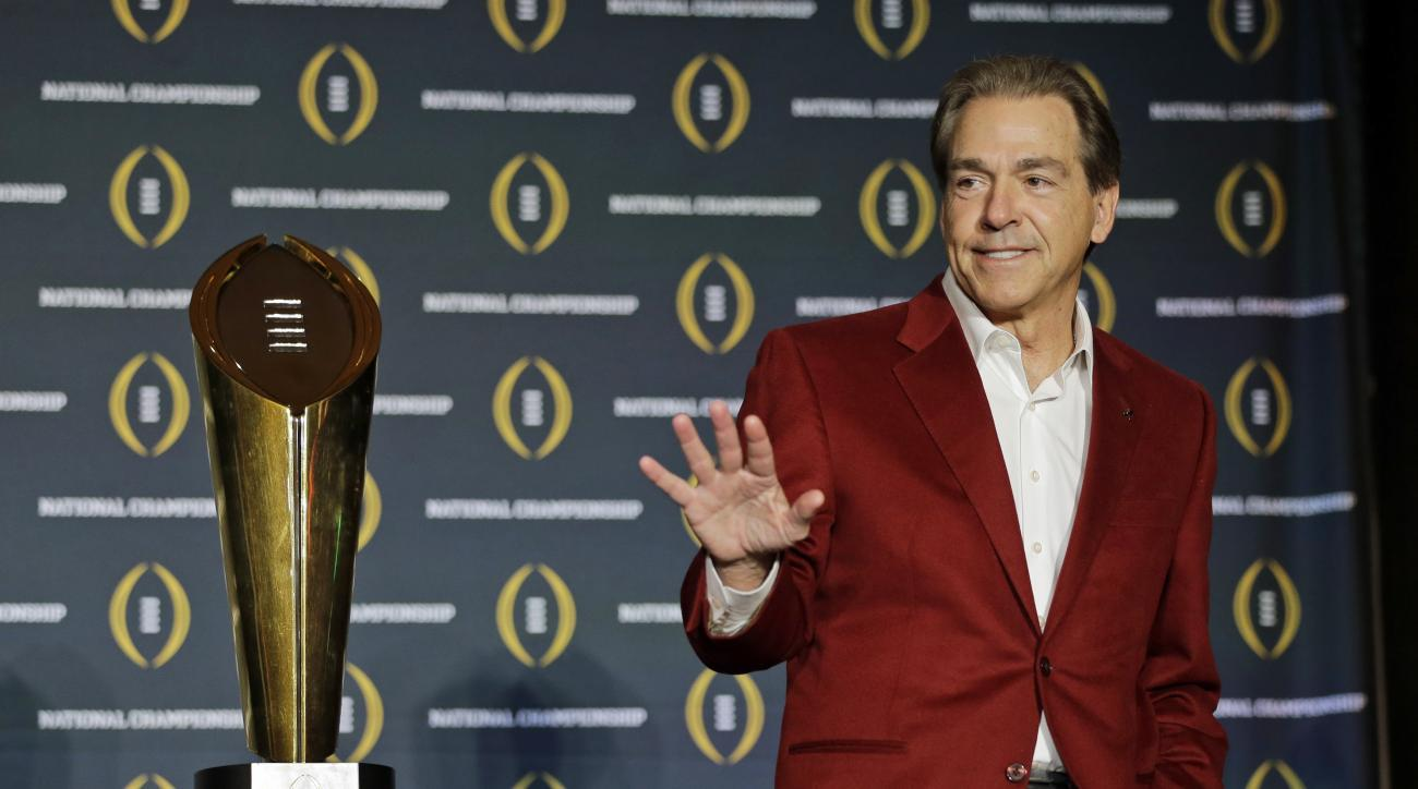 FILE - In this Jan. 12, 2016, file photo, Alabama head coach Nick Saban poses with the championship trophy during a news conference for the NCAA college football playoff championship in Scottsdale, Ariz.  Saban is one national title away from matching Bea