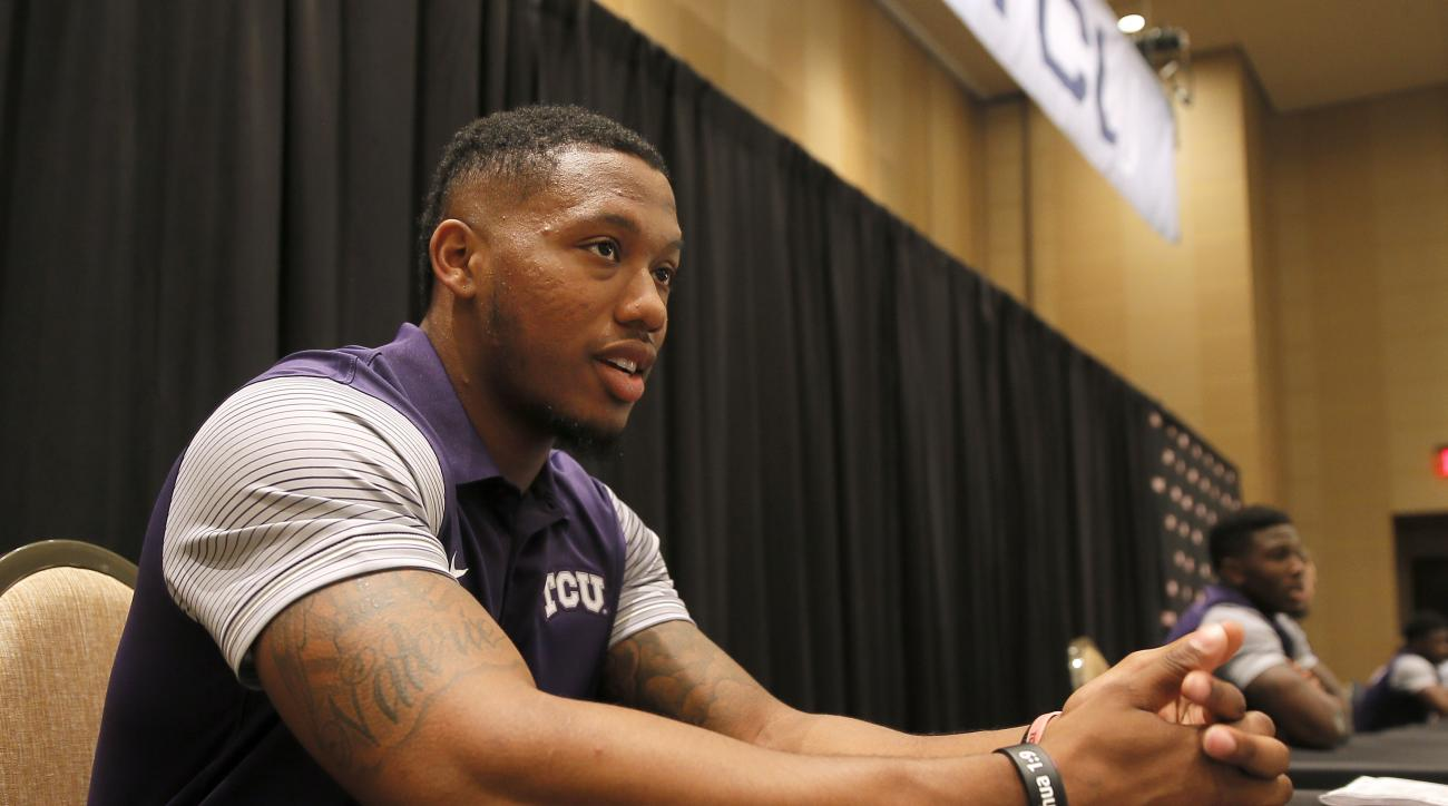 FILE - In this July 18, 2016, file photo, TCU defensive end Josh Carraway responds to questions during Big 12 college football media days, in Dallas. Carraway was one of the leagues top pass-rushers with nine sacks last season.  (AP Photo/Tony Gutierrez,