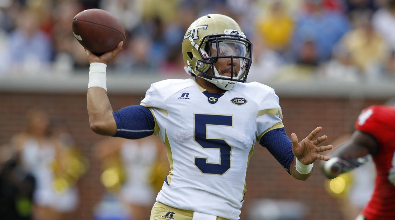 FILE - In this Nov. 28, 2015, file photo, Georgia Tech quarterback Justin Thomas (5) passes against Georgia in the second half of an NCAA college football game in Atlanta, Ga. Senior quarterback Justin Thomas is eager to play alongside some familiar faces