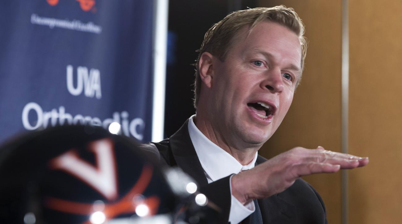 FILE - In this Dec. 7, 2015, file photo, Virginia coach Bronco Mendenhall speaks during an NCAA college head football news conference in Charlottesville, Va. Mendenhall arrives from BYU to lead a program with one winning season in eight years. (AP Photo/S