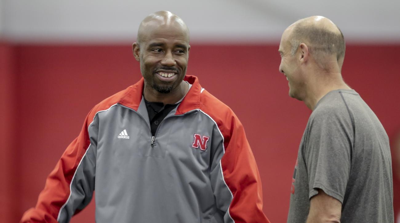 In this Aug. 9, 2016, photo, Nebraska wide receivers coach Keith Williams, left, laughs with head coach Mike Riley during NCAA college football team practice in Lincoln, Neb. Williams was arrested on suspicion of drunken driving after a car crash involvin