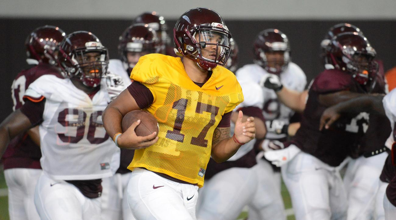 This Monday Aug. 15, 2016, image provided by the Virginia Tech Sports Information department shows freshman quarterback Josh Jackson during practice in Blacksburg, Va. Virginia Tech coach Justin Fuente says the two-way battle for the starting quarterback