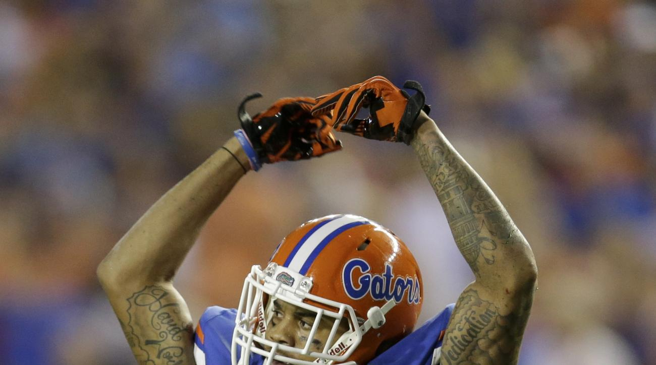 Florida defensive back Jalen Tabor rises his arms to fans as they cheer during the first half of an NCAA college football game against New Mexico State, Saturday, Sept. 5, 2015, in Gainesville, Fla. (AP Photo/John Raoux)