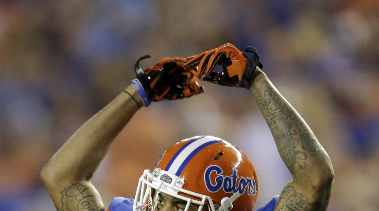 FILE - In this Sept. 5, 2015, file photo, Florida defensive back Jalen Tabor raises his arms to fans as they cheer during the first half of an NCAA college football game against New Mexico State in Gainesville, Fla. Florida coach Jim McElwain has suspende