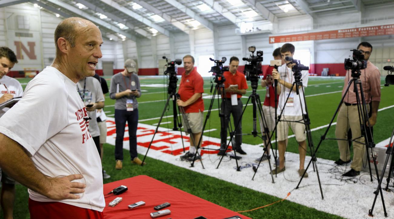 Nebraska coach Mike Riley speaks to reporters following NCAA college football practice in Lincoln, Neb., Wednesday, Aug. 17, 2016. Coach Riley said his team has shown great resiliency in the wake of punter Sam Foltz's death and receivers coach Keith Willi