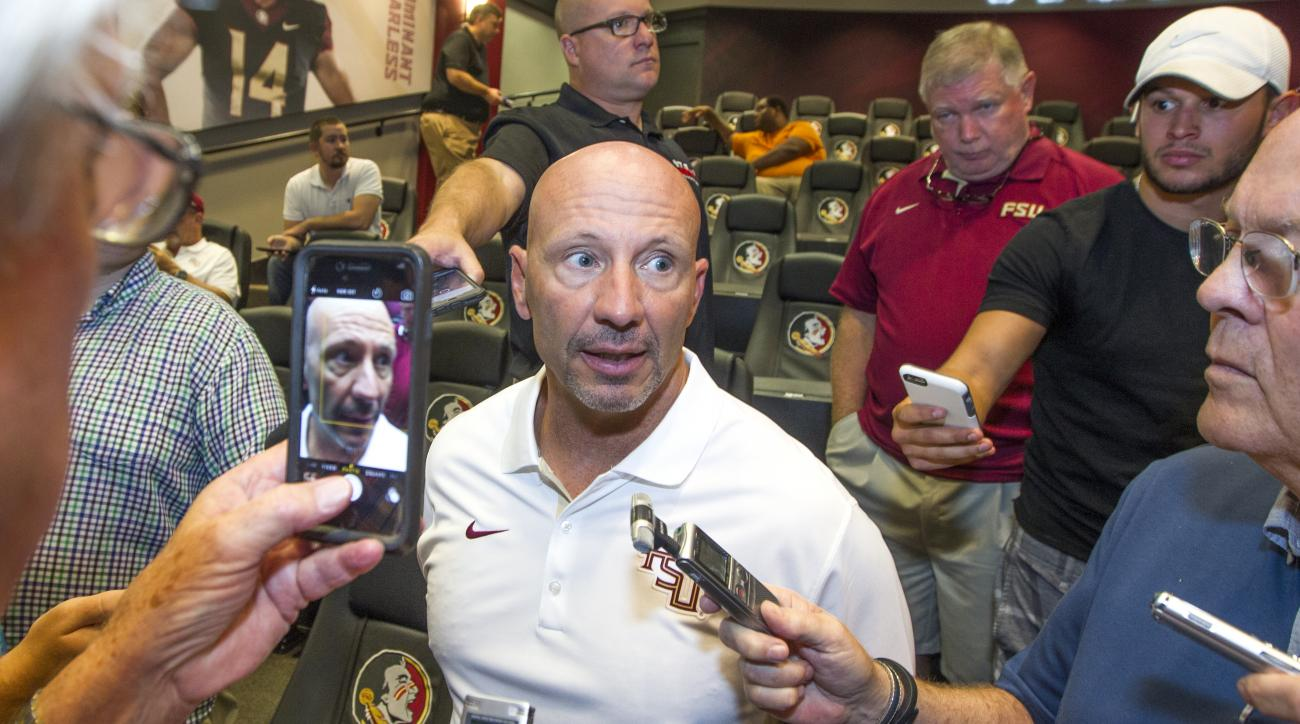FILE- In this Aug. 9, 2015 file photo, Florida State defensive coordinator Charles Kelly talks during NCAA college football media day in Tallahassee, Fla. Kelly enters his third season as the Seminole's defensive coordinator with a unit that features defe