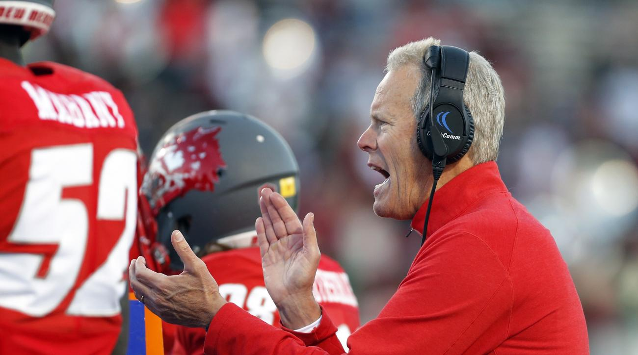 FILE - In this Nov. 21, 2015, file photo, New Mexico head coach Bob Davie applauds his players during the first half of an NCAA college football game against Colorado State in Albuquerque, N.M. In his fourth season, Davies reconstruction of the Lobos prog