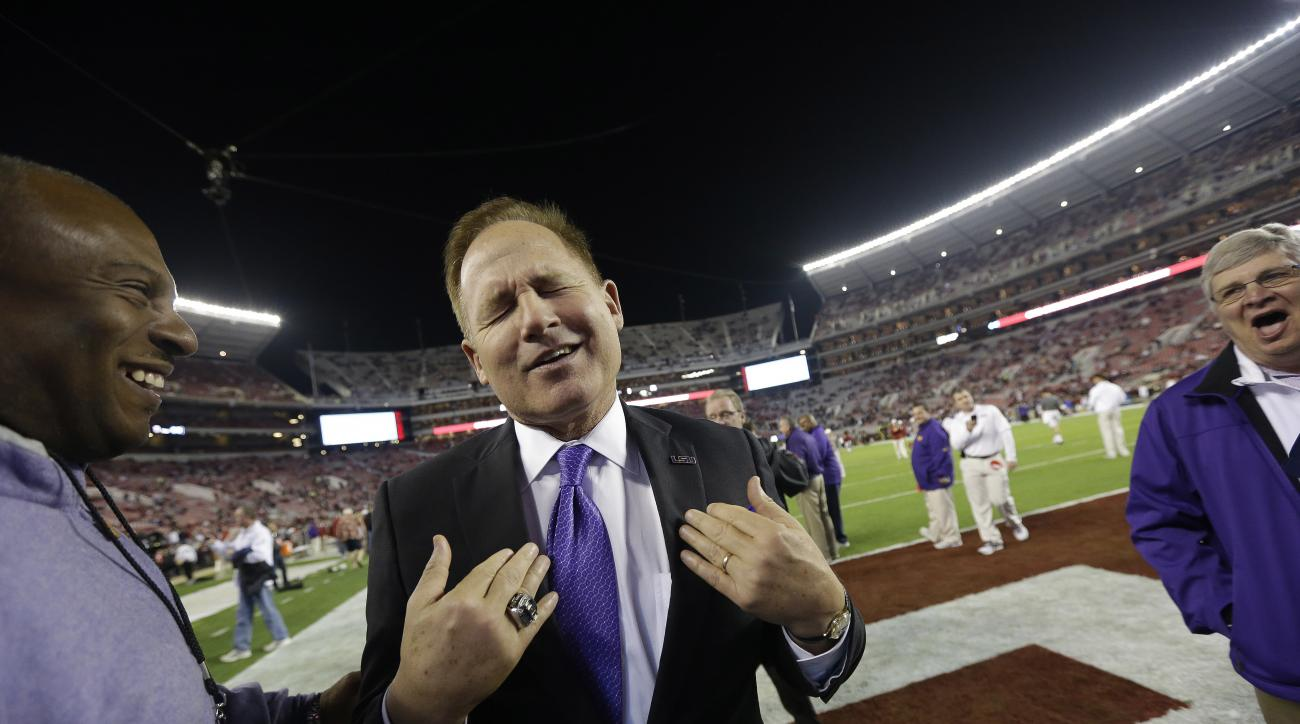 FILE - In this Nov. 9, 2013, file photo, LSU head coach Les Miles reacts to Alabama fans booing before the first half of an NCAA college football game against Alabama, in Tuscaloosa, Ala. Miles is more in touch with his coaching mortality than ever, yet s