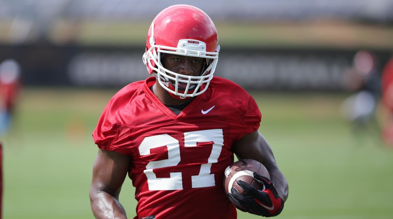 In this Monday, Aug. 1, 2016,  file photo, University of Georgia NCAA college football tailback Nick Chubb (27) runs a drill during the first day of practice, in Athens, Ga. Chubb's left knee injury was so grotesque, his leg bent horribly out when he was