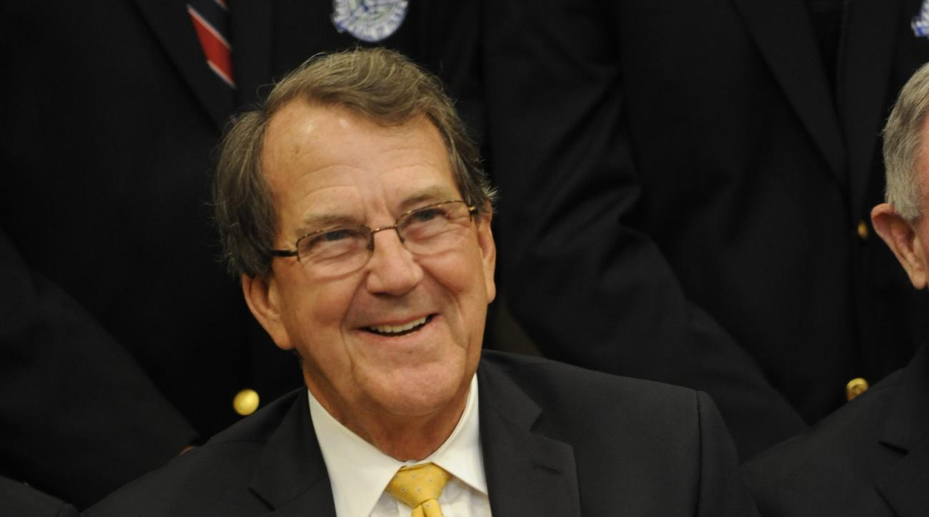 Michigan coach Lloyd Carr poses for a photo prior to the dinner at the Hall's Enshrinement Festival Saturday July 21, 2012 in South Bend, Ind.  (AP Photo/Joe Raymond)