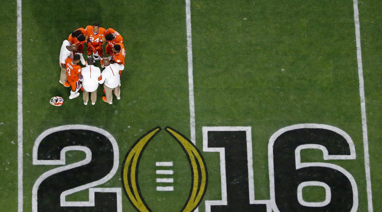 FILE - In this Jan. 11, 2016, file photo, Clemson players huddle before the NCAA college football playoff championship game against Alabama, in Glendale, Ariz. Alabama is No. 1 in The Associated Press preseason Top 25. Clemson is No. 2. (AP Photo/Ross D.