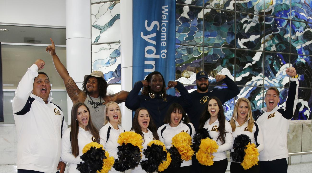 California Golden Bears cheerleaders welcome players as they arrive at Sydney International airport in Sydney, Australia, Monday, Aug. 22, 2016. A chartered Boeing 777 touched down at Sydney airport on Monday morning, delivering the California Golden Bear