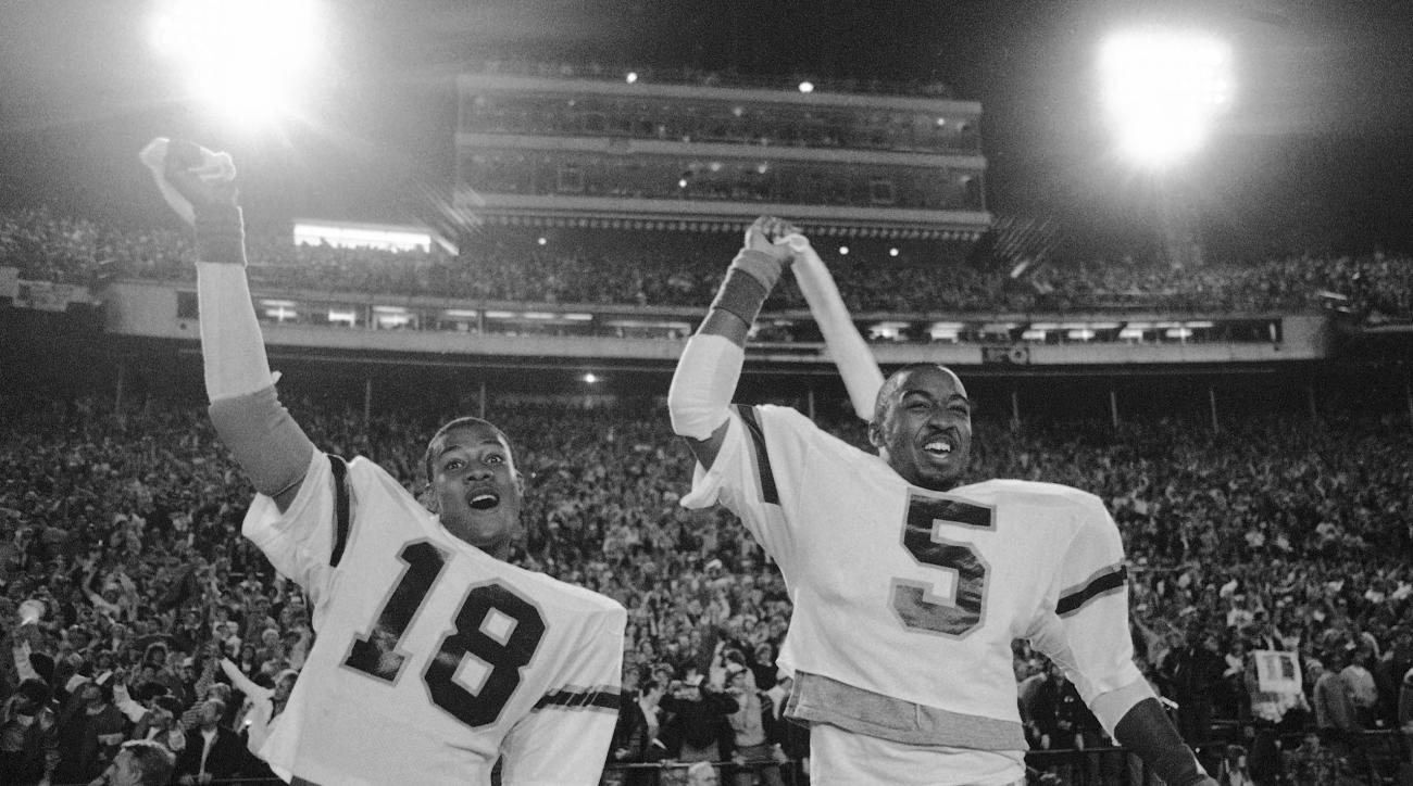 FILE - In this Jan. 3, 1984, file photo, Miami's Tolbert Bain (18) and halfback Melvin Bratton (5) celebrate 31-30 win over Nebraska in the 50th Annual Orange Bowl Classic NCAA college football game in Miami. With three national titles in the 1980s _ all
