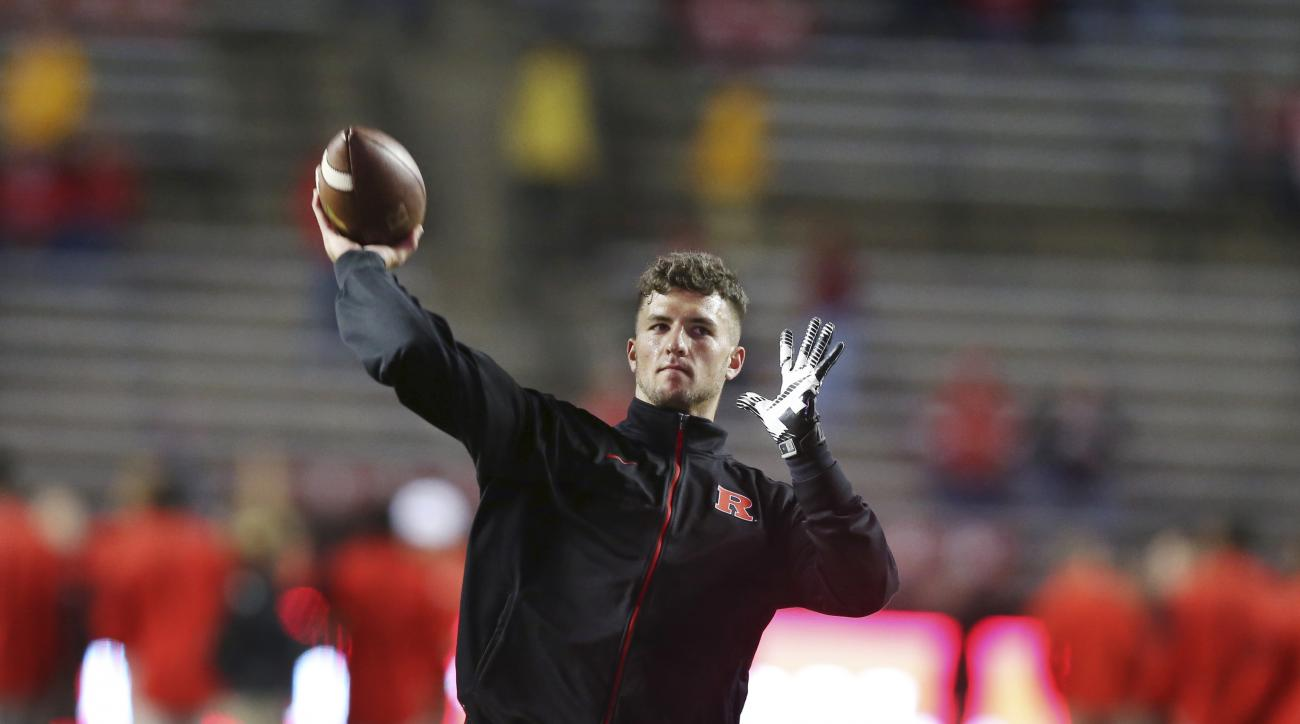 FILE - In this Oct. 24, 2015 file photo, Rutgers quarterback Chris Laviano throws a pass as the team warms up before an NCAA college football game against Ohio State in Piscataway, N.J. Rutgers first-year coach Chris Ash announced on Monday, less than two