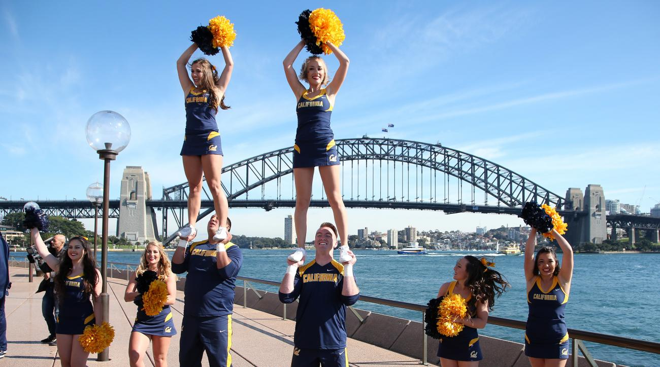 The California Golden Bears' cheerleaders perform a routine with the Harbour Bridge at the back as they take advantage of the sites around Sydney, Tuesday, Aug. 23, 2016, ahead of their opening college football game of the season against the Hawaii Rainbo