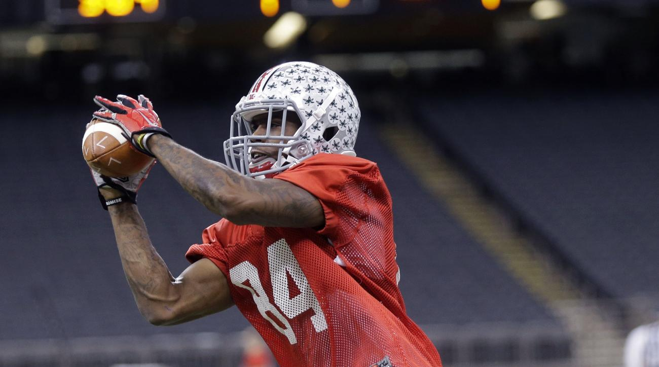 FILE - In this Dec. 29, 2014, file photo, Ohio State wide receiver Corey Smith (84) goes through drills during practice at the Mercedes-Benz Superdome in New Orleans. The departure of the Ohio States 3 best receivers makes for a jumbled depth chart as the