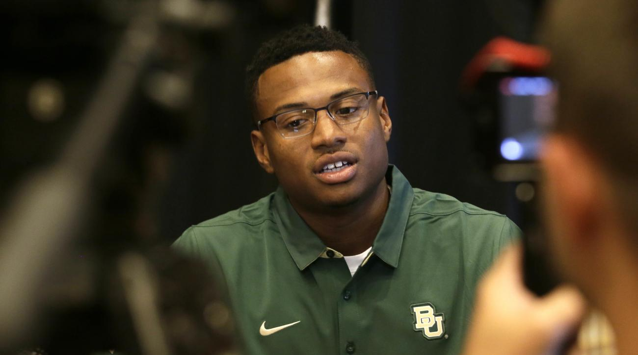 FILE - In this July 19, 2016, file photo, Baylor defensive back Ryan Reid speaks to reporters during Big 12 college football media days in Dallas. Senior cornerback Ryan Reid now keeps up with teammates off the field. Much of that is trying to build chemi