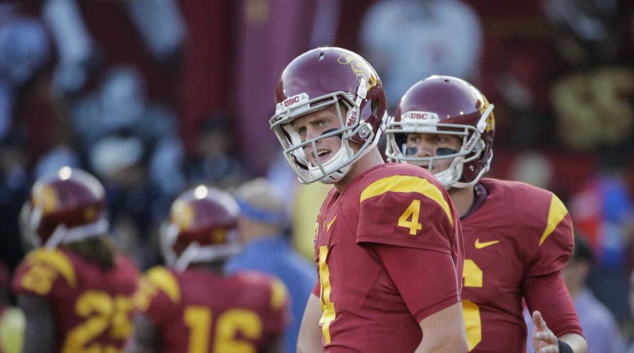 FILE - In this Oct. 8, 2015, file photo, Southern California quarterback Max Browne warms up before the team's NCAA college football game against Washington  in Los Angeles. After backing up Cody Kessler for the last two seasons, the redshirt junior Brown